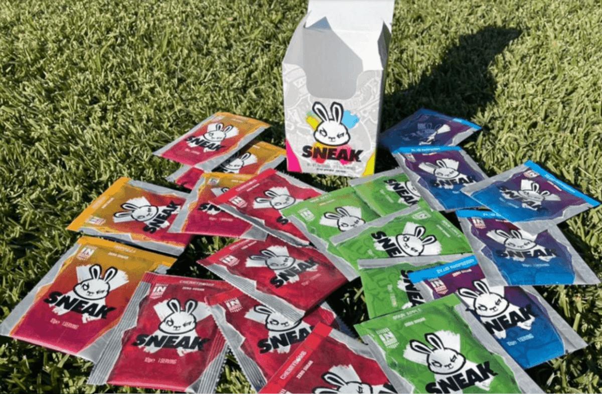 Sneak energy drink sachets on the grass