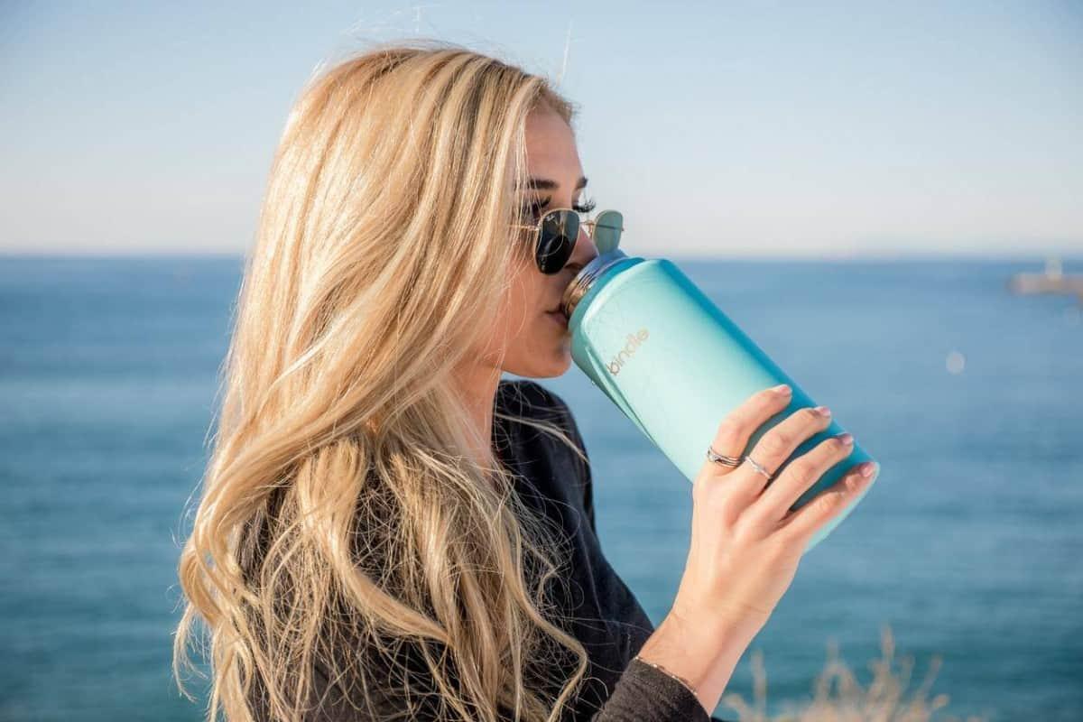 Girl drinking in a bottle