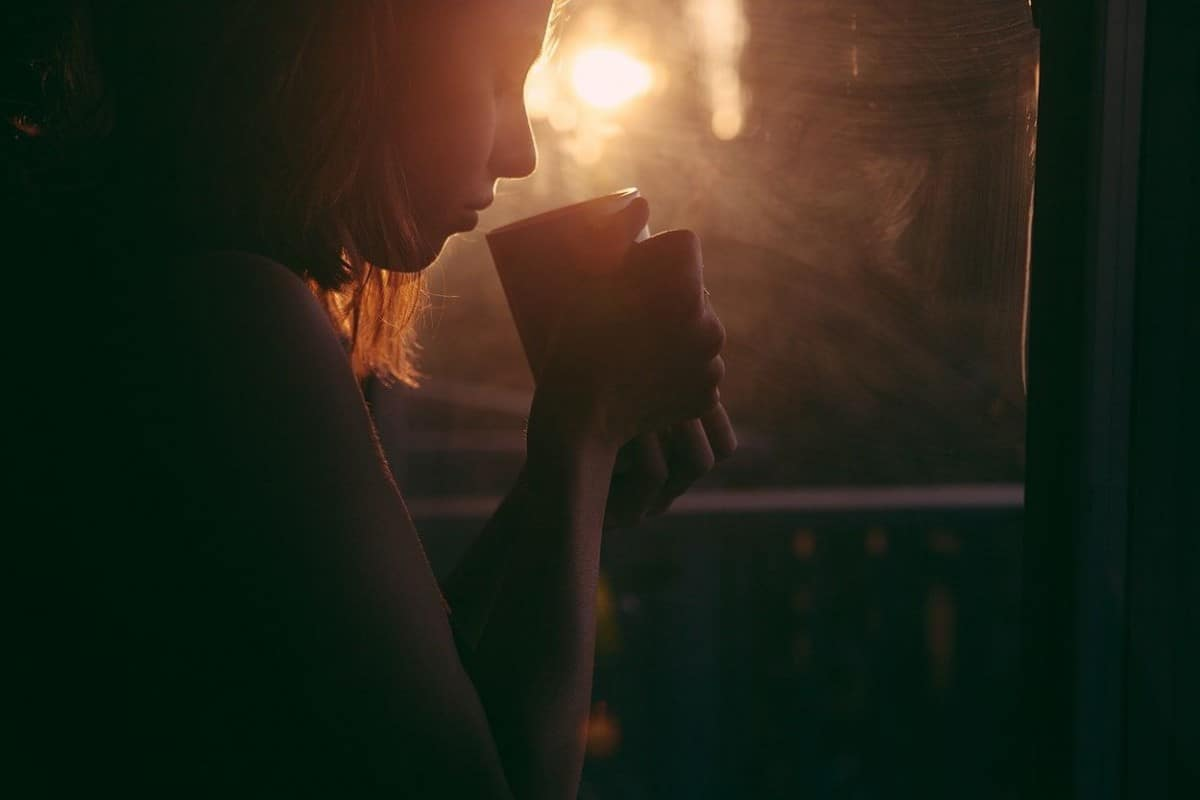 A girl with a cup of coffee.