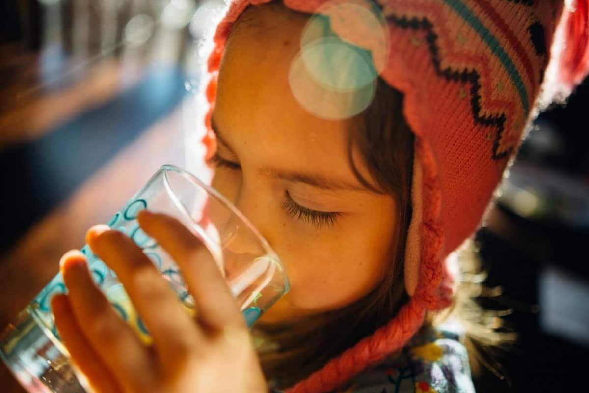 child drinking a beverage