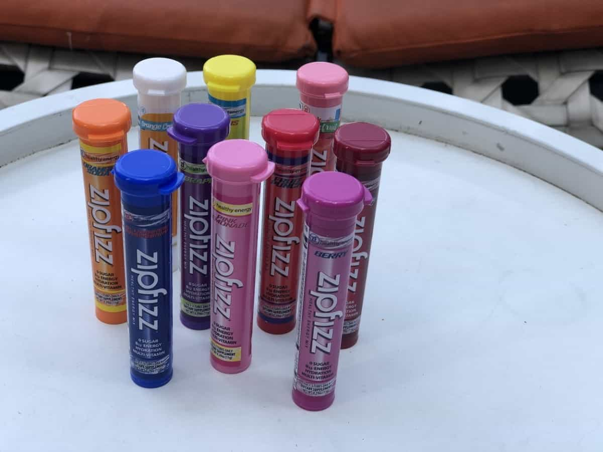 Picture showing a bunch of Zipfizz energy powder tubes