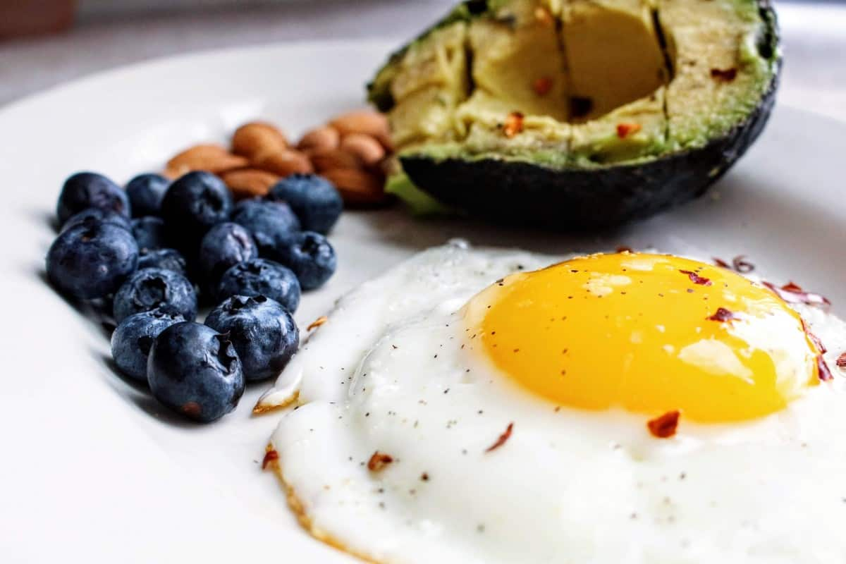 Blueberries, nuts, an avocado, and a fried egg