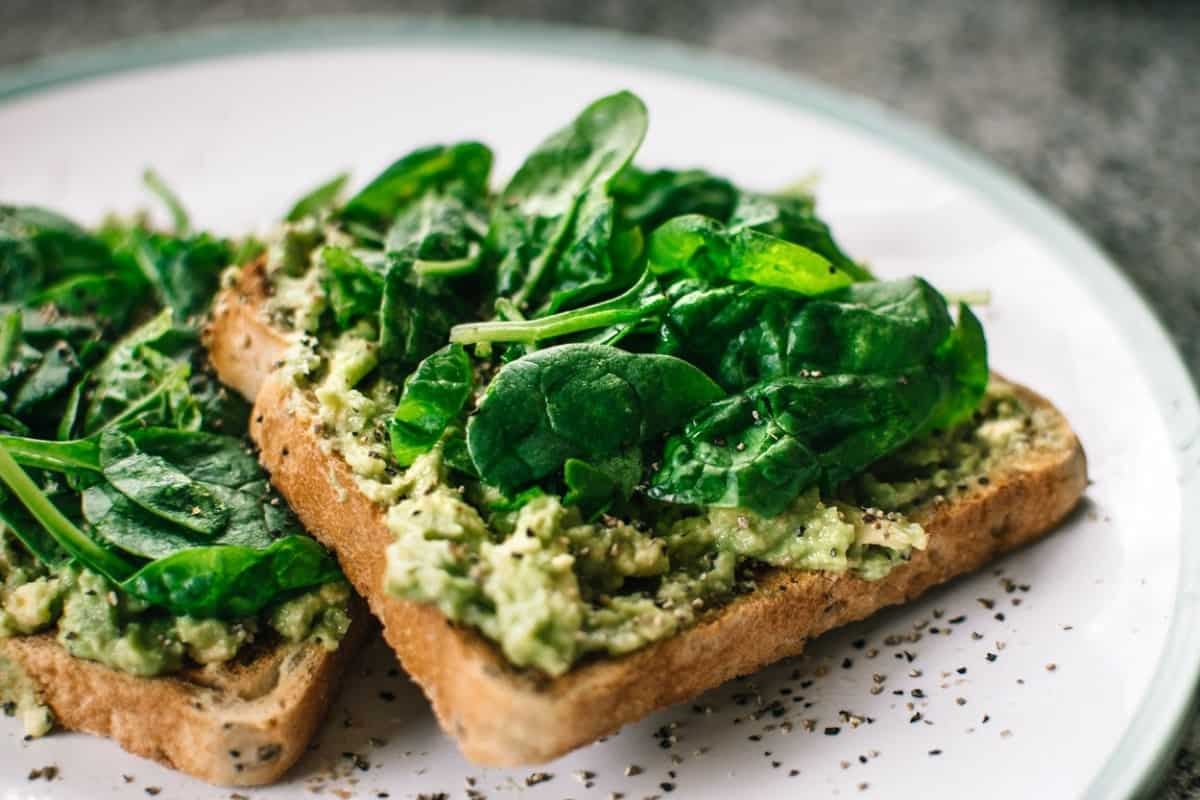 Green vegetables on top of toast