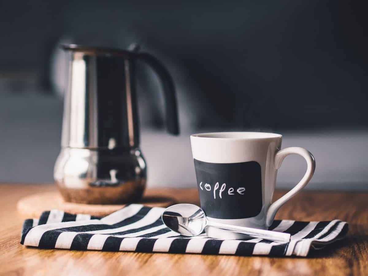 A flask and a cup of coffee.