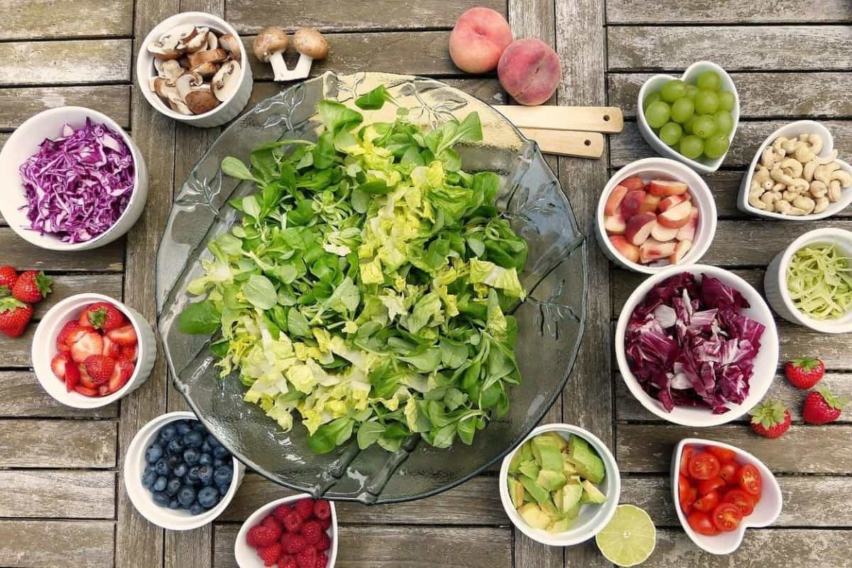 Different fruits and vegetables in different bowls.