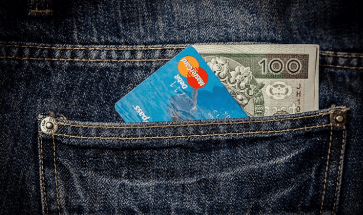 Money and visa card in the pocket of jeans.
