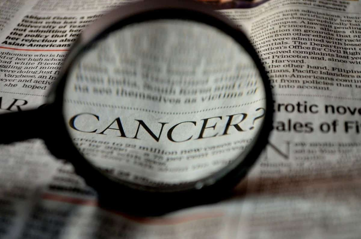 Cancer headline under a magnifying glass.